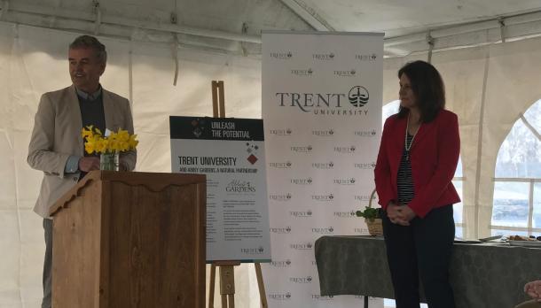 Leo Groarke standing at podium, Julie Davis standing