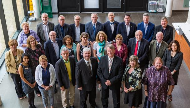 members of the board all gather for a group photo