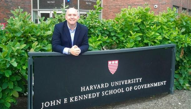 trent Ph.D candidate studying at the frost centre stands outside of Harvard university after being consulted on leadership