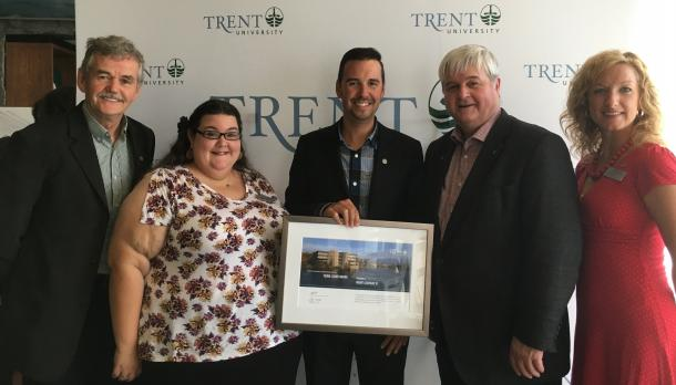 Trent Alumni gather for a photo celebrating outstanding achievement by Trent University Graduates