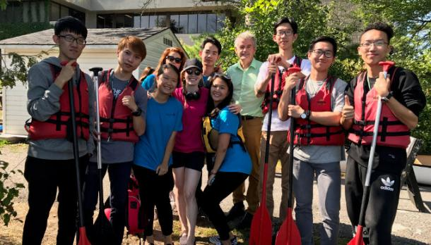 President Leo Groarke wishes new international students well before their first paddling experience
