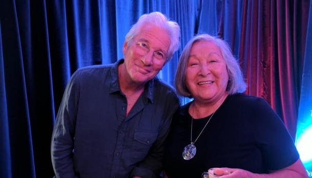 Richard Gere and Edna Manitowabi smiling to camera at the award ceremony