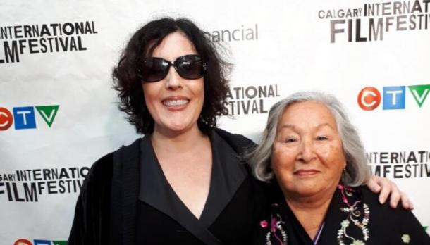 Edna Manitowabi with another actress at the International Film festival smiling to camera while standing in front of back drop