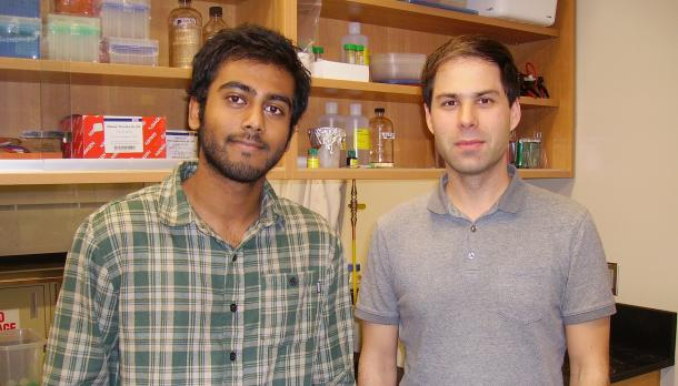 2 men standing next to each other in a lab at Trent University