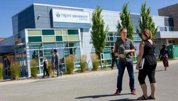 Faculty ember speaking to a student outside Trent University Durham GTA
