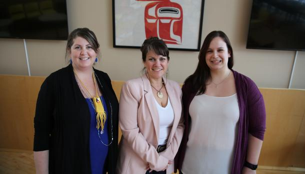 Linday Garneau, Dr. Dawn Lavell-Harvard and Brenna Farren smiling into the camera