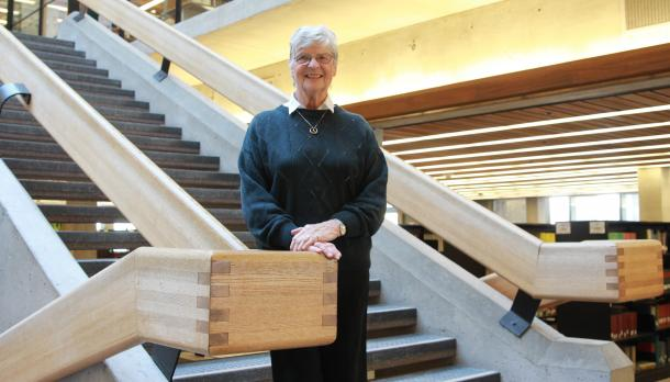 Gillian Stamp smiling on the stairs in Bata Library