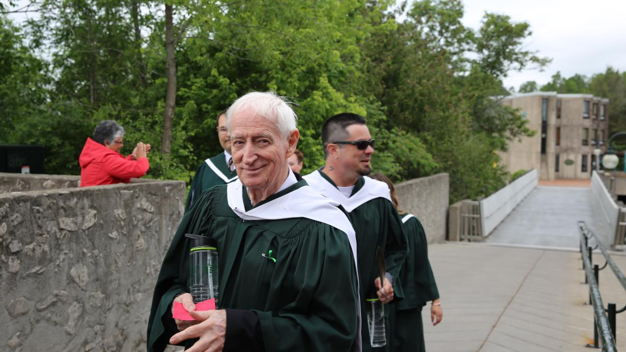 84 year-old Victor Parker processes toward the Convocation ceremony