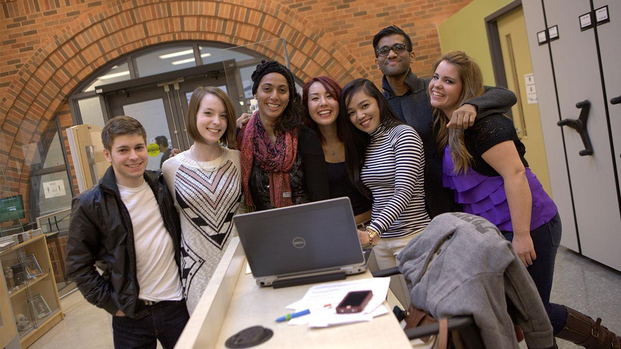 Smiling students gathering for a photo at Trent's Durham campus.