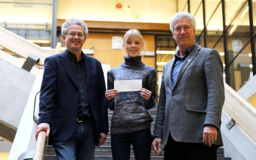 Maddie Trottier is presented with the James S. Miller Memorial Scholarship by orests Ontario CEO Rob Keen and Dr. Stephen Bocking, chair of the Environmental and Resource Studies/Science program at Trent