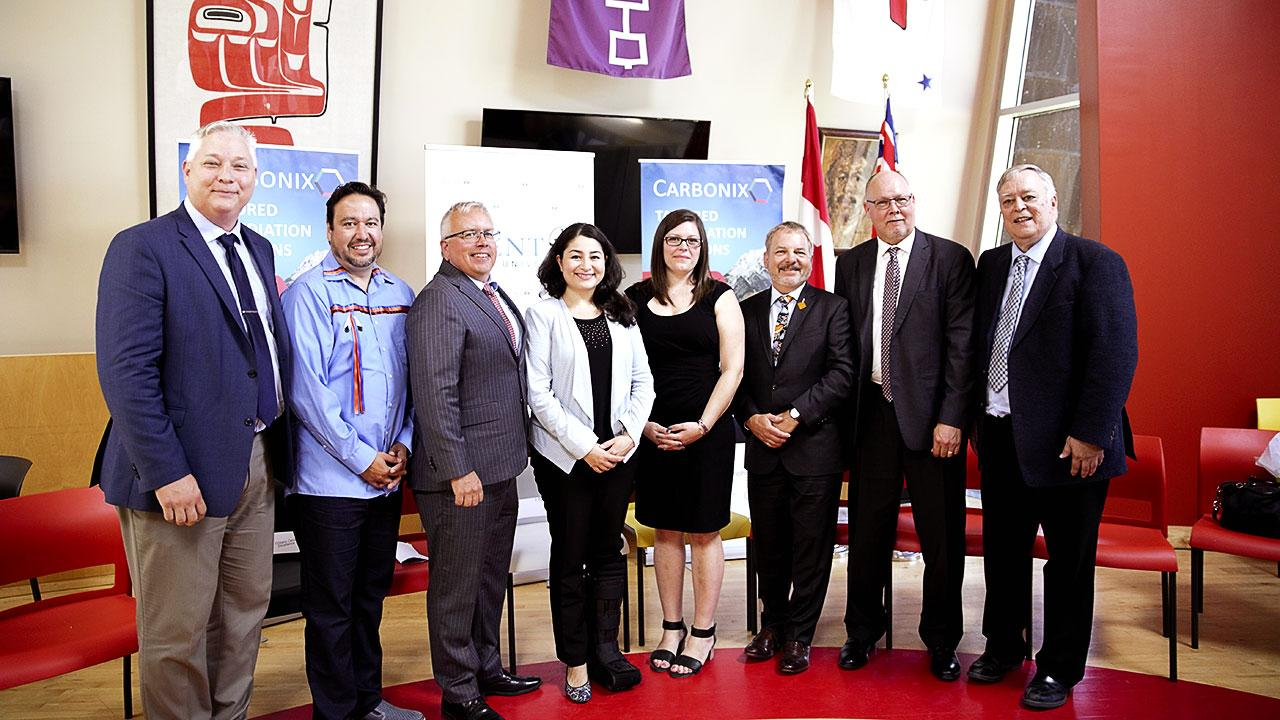 Dignitaries and VIP's pose for a group photo a the Carbonix funding announcement.