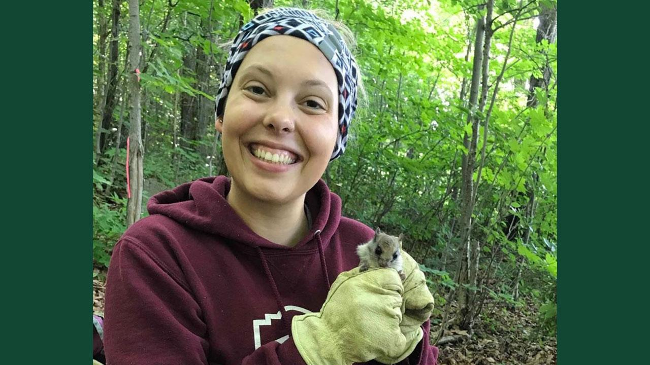 Trent University's Sasha Newar with a northern flying squirrel.