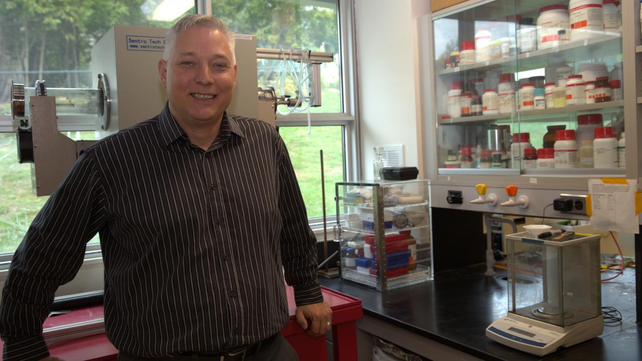 Dr. Andrew Vreugdenhil smiling at the camera