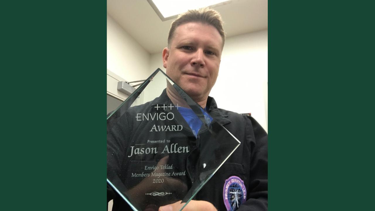 Jason Allen, Trent's Manager of Animal Care poses with the Envigo Award