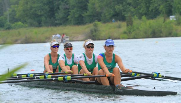 4 Trent athletes rowing for the Ontario Championships on a sunny summer morning