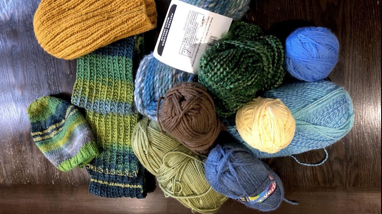 An assortment of yarn and knit items.