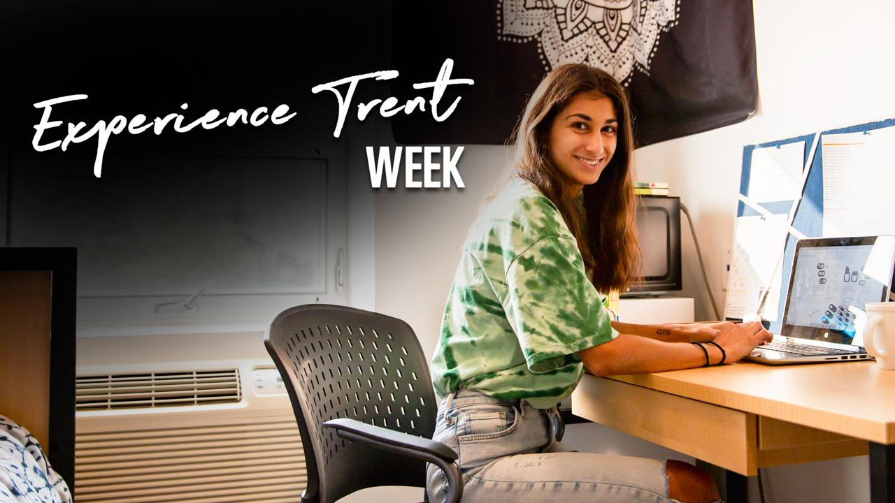 Experience Trent Week, Student working on laptop in residence room.
