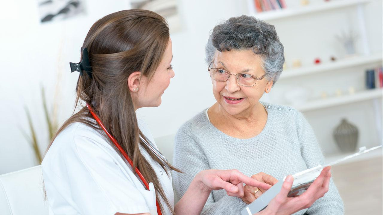 A healthcare professional assisting a woman.