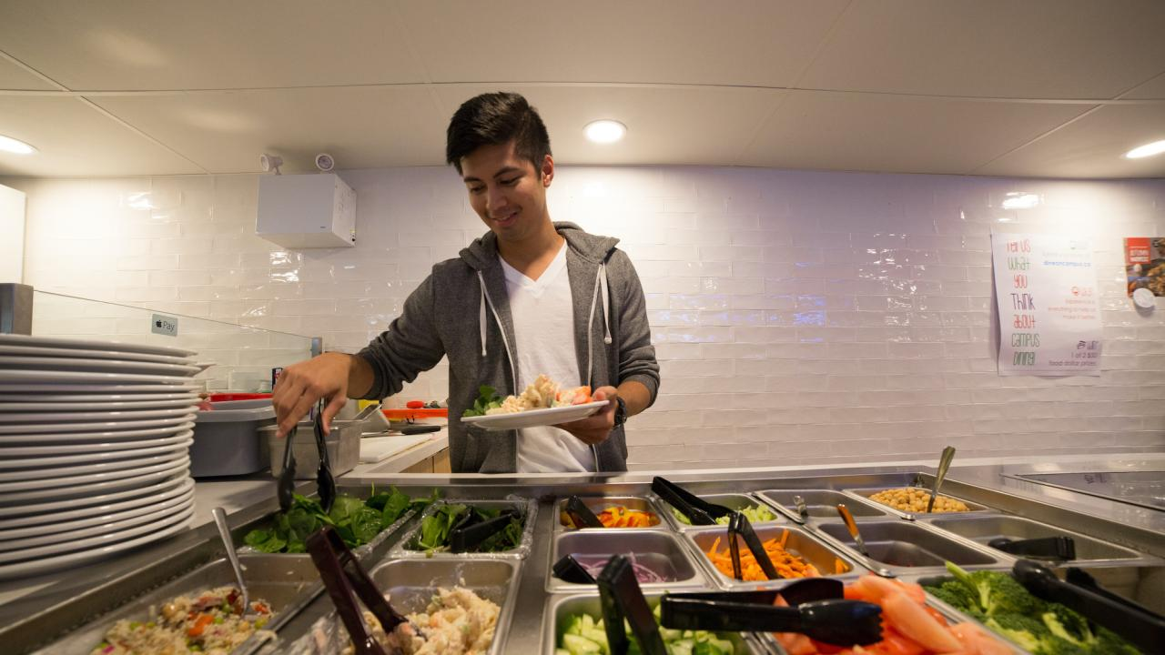 A student serving himself at Trent University food services
