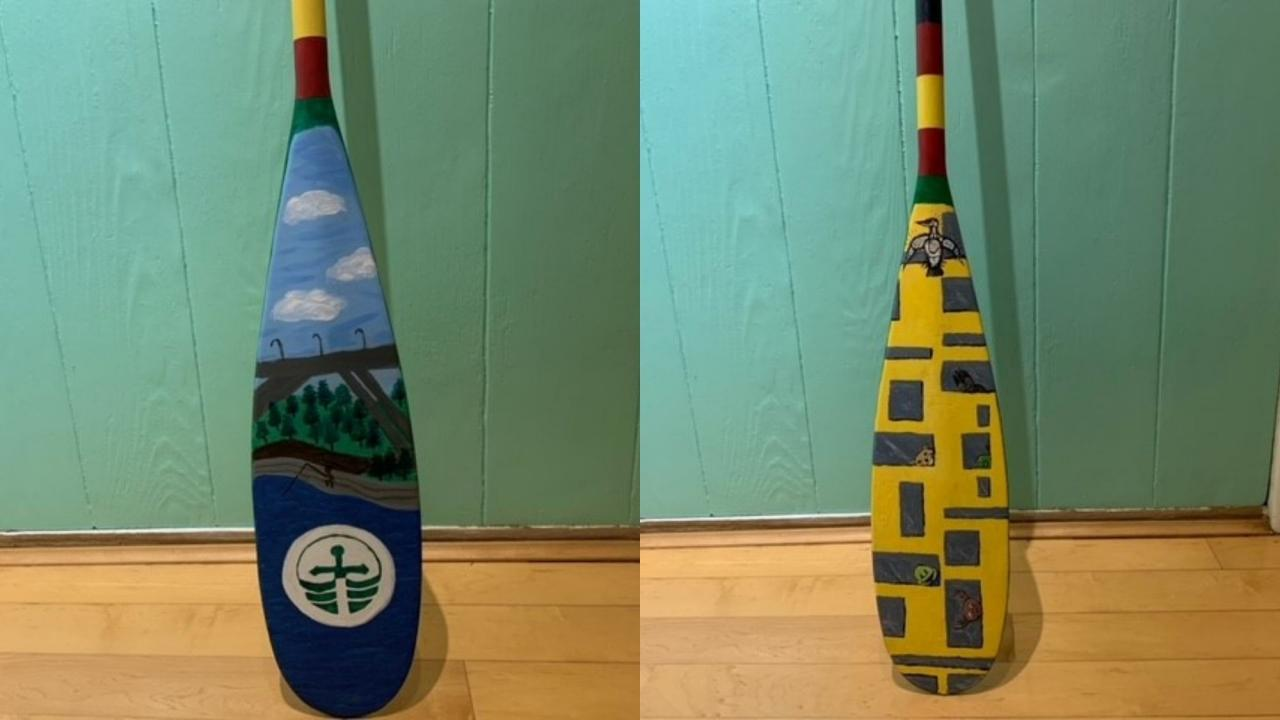 Two sides of the painted paddle