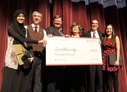 Onstage for the announcement: International Student Maryam Azraa Azizuddin, TIP Director Michael Allcott, Scotiabank Branch Manager Brian O'Toole, Scotiabank Executive Vice-President Sue Graham Parker, Trent President Steven E. Franklin, and TISA President Airin Aguilera