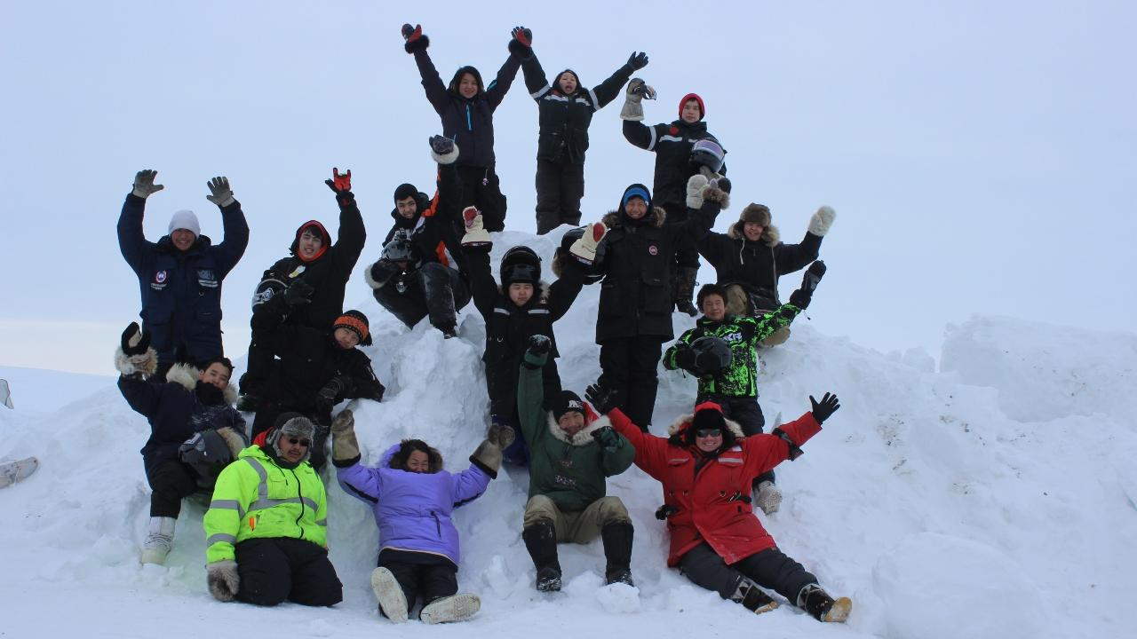 Dr. Whitney Lackenbauer and youth involved in the Junior Canadian Rangers program.