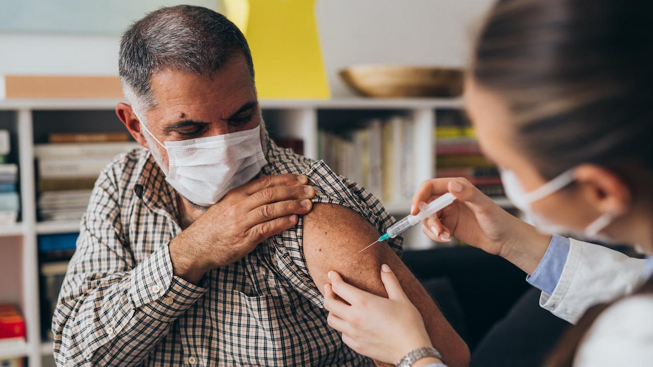 A man receiving a vaccine.