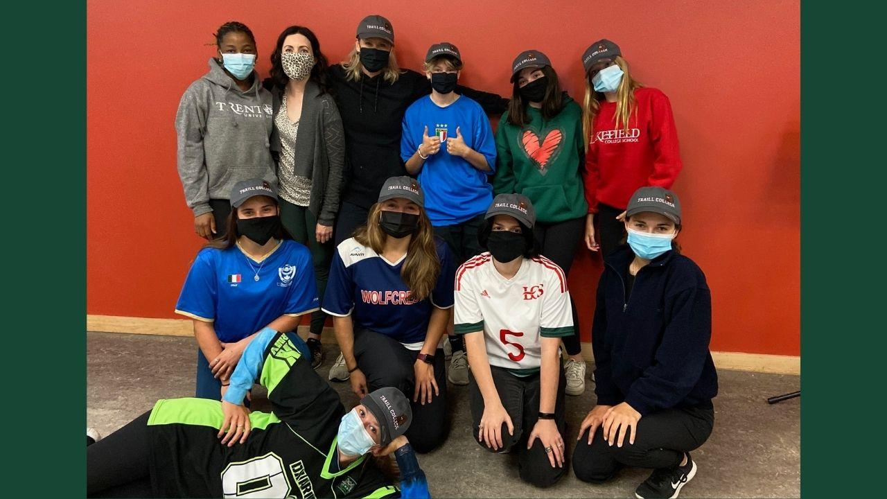 A group of participating students standing together wearing masks.