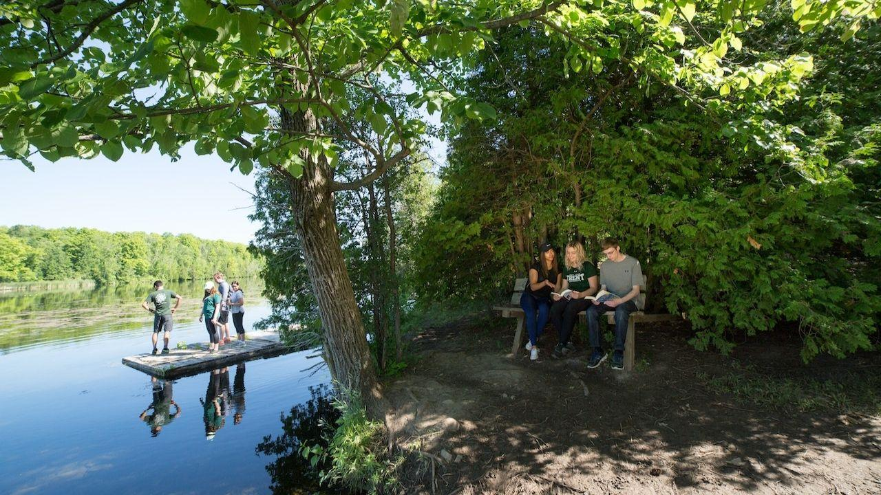 Students socializing in nature on Trent University's campus