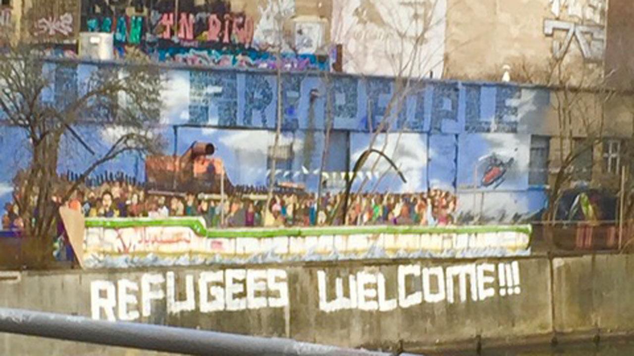 Refugees Welcome written across a bridge.