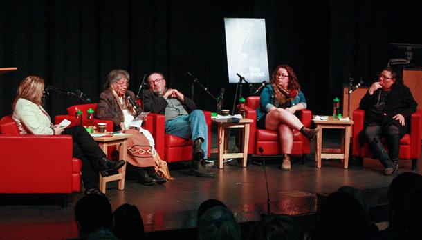 Professor Shirley Williams, Dr. John Milloy, professor emeritus and special advisor to the Truth and Reconciliation Commission; Karissa Dawn Martin, Indigenous Studies and History student and Liz Stone, executive director of Niijkiwendidaa Anishnaabe-Kwewag sitting in red chairs on a stage with microphones, in front of an audience