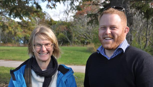 Dr. Pauline Marsh and Mr. Skinner smiling to camera on a cloudy fall day