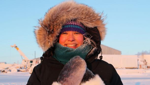 Shirin Nuesslein stands in full winter outerwear smiling at camera outside in Canada's North