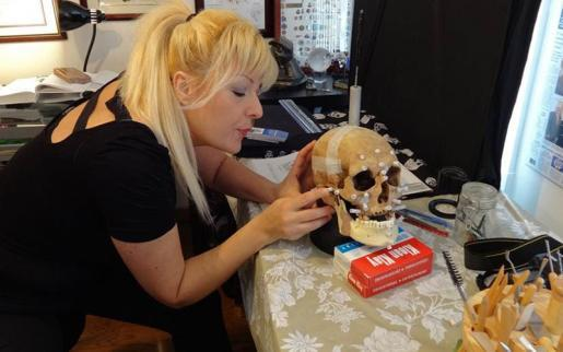 Forensic artist Diana Trepkov performing craniofacial reconstruction