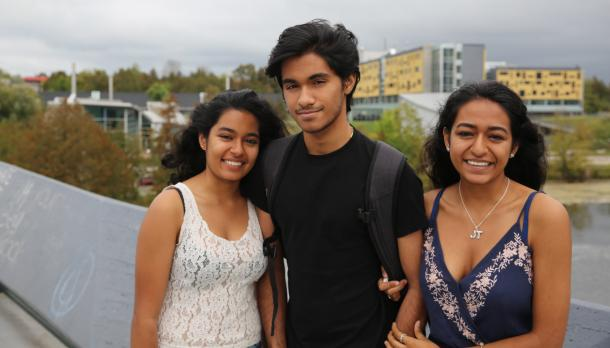 The Narine triplets standing beside each other and smiling on the Faryon Bridge.