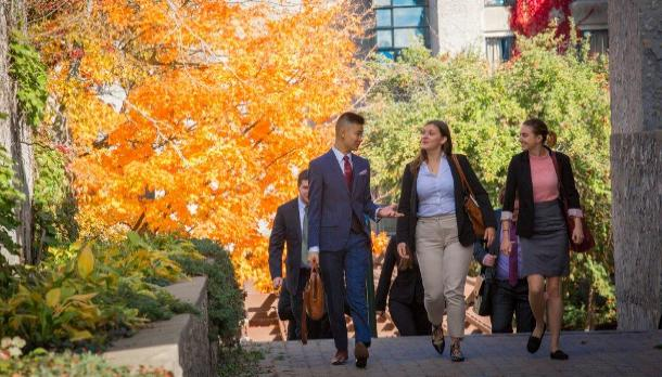 Students walk along Champlain College in fall