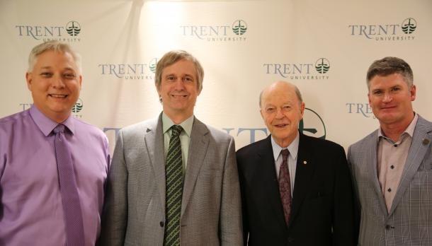 Faculty and staff of Green Chemistry standing in front of the Trent University zap banner