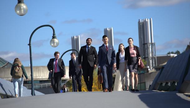 Students walking across the Faryon Bridge on the Symons Campus of Trent University