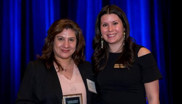 Dr. Alba Agostino receiving her award