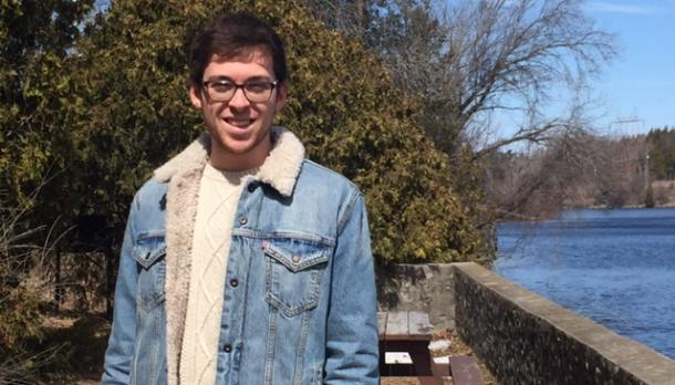 Andrew Stranaghan standing in front of Otonabee river
