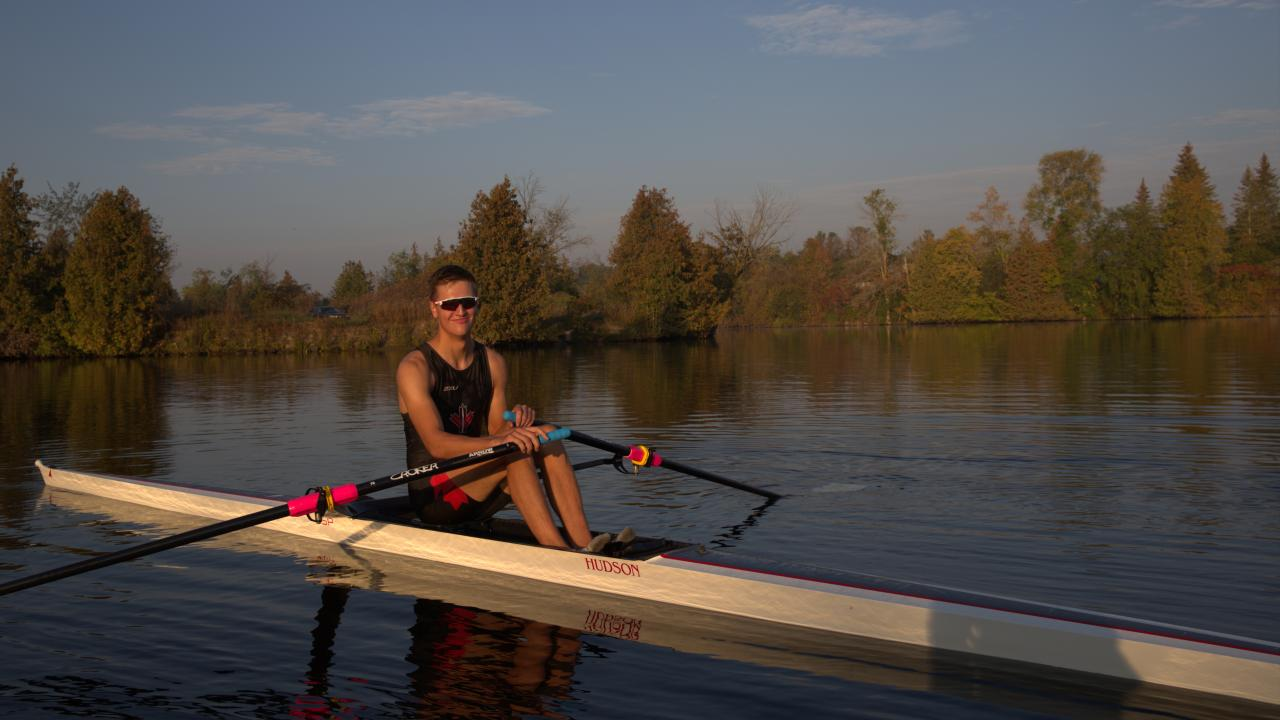 Trevor Jones rowing on the Otonabee River in the Fall