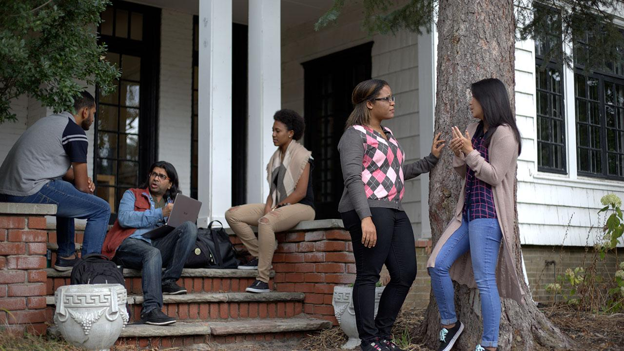 Students gathered around the entrance of a building at Catharine Parr Traill