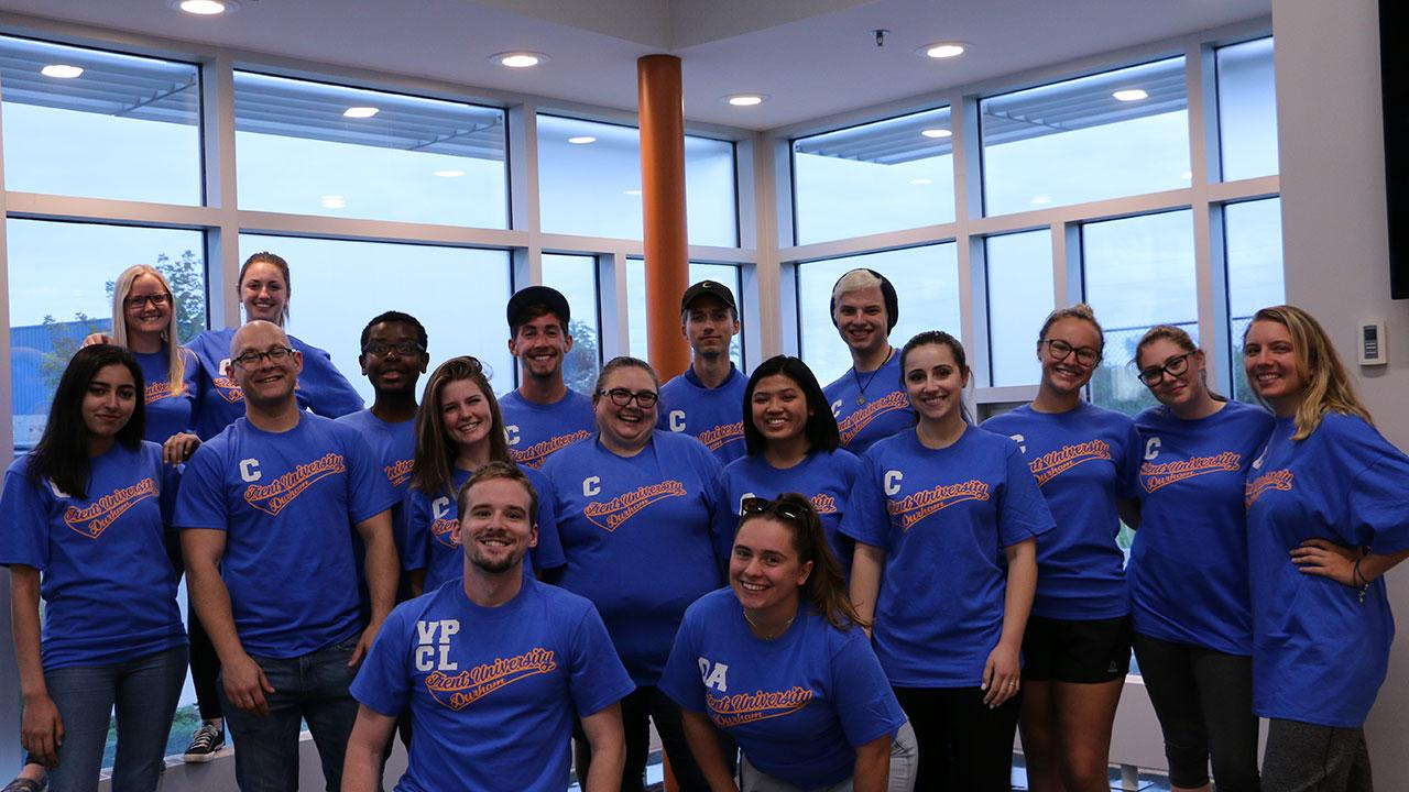 Group of Orientation Week leaders smiling for a photo at the Trent Durham campus