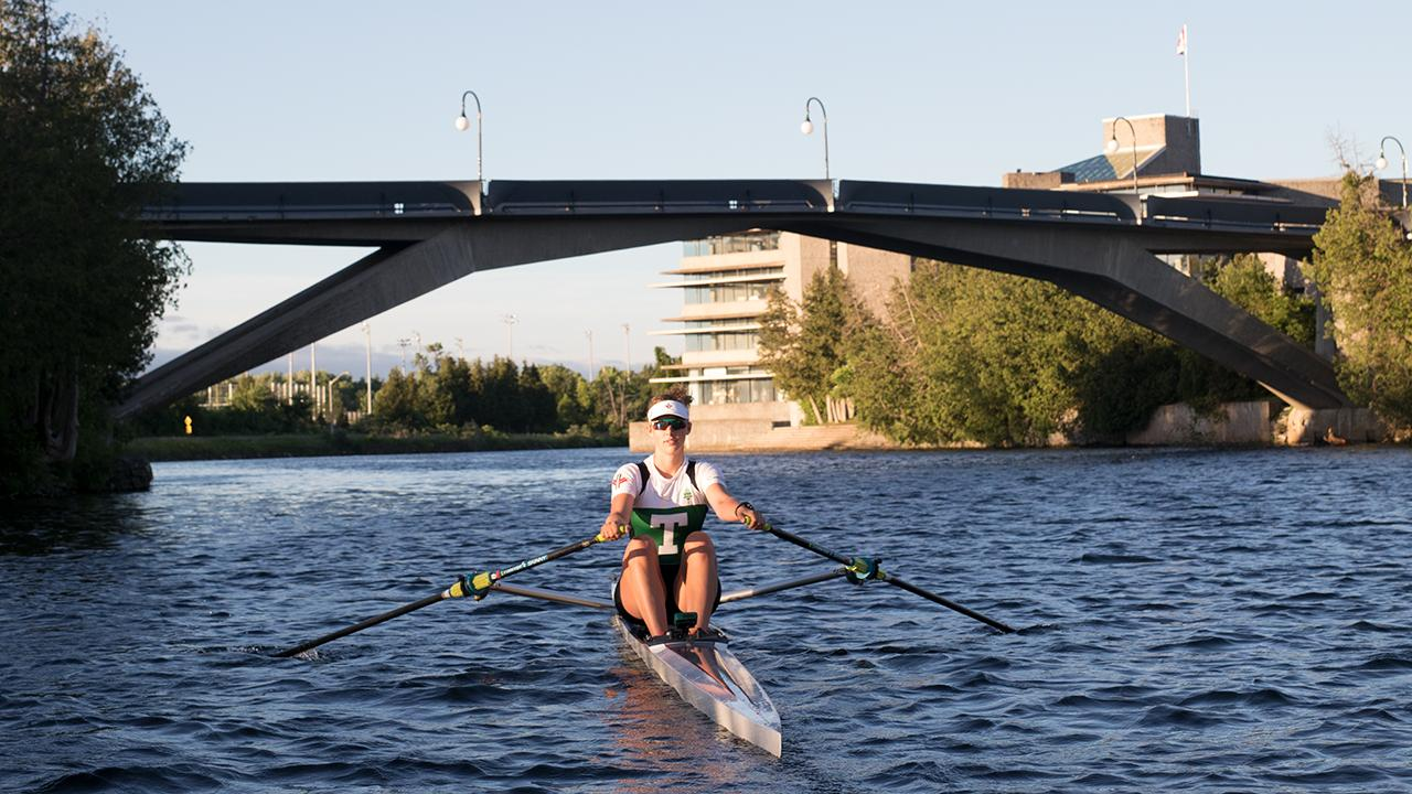Excalibur rower Grace VandenBroek on the Otonabee River, Symons Campus, Trent University