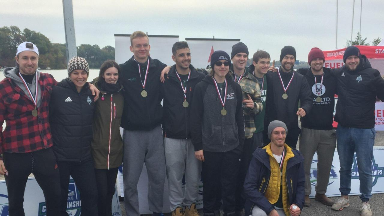 Trent University rowing team members wearing their medals.