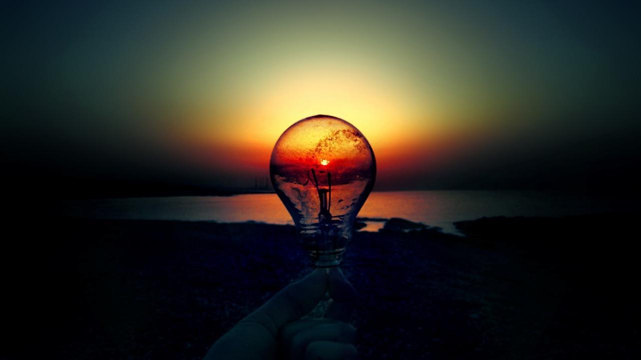 lighbulb infront of sunset