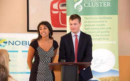 Andressa Lacerda, Trent Ph.D. candidate and COO, Noble Purification Inc, and Adam Noble, CEO, Noble Purification Inc, at the announcement at Gzowski College on August 26.