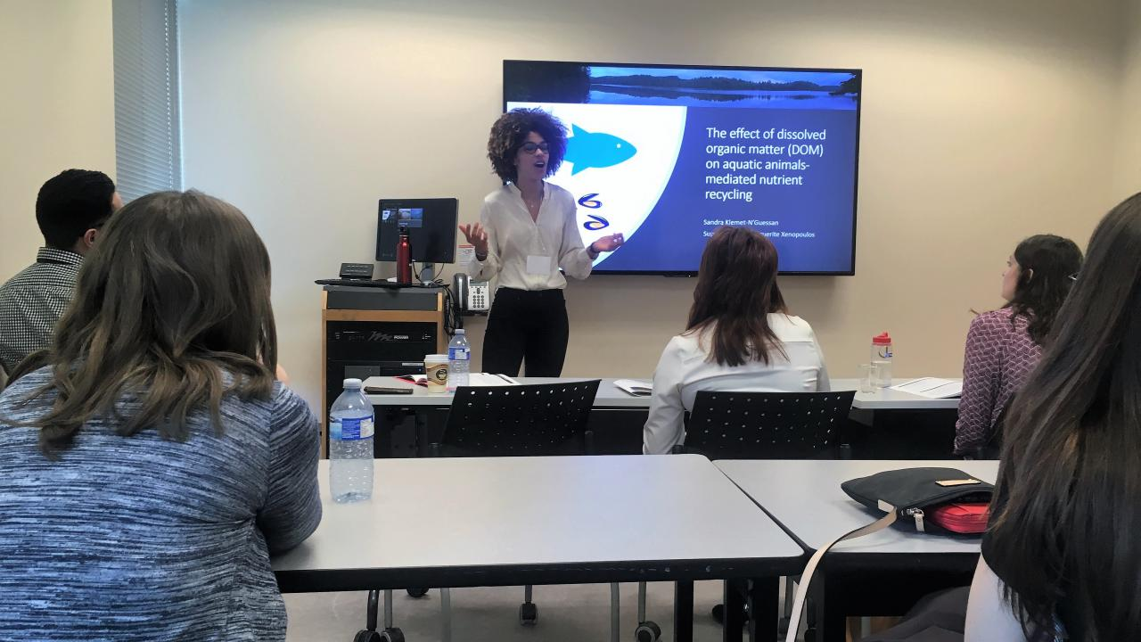 """Graduate student Sandra Klemet-N'guessan presenting her current project on aquatic animals-mediated nutrient cycling at the TGSS symposium."" (Photo taken by Verena Sesin)"