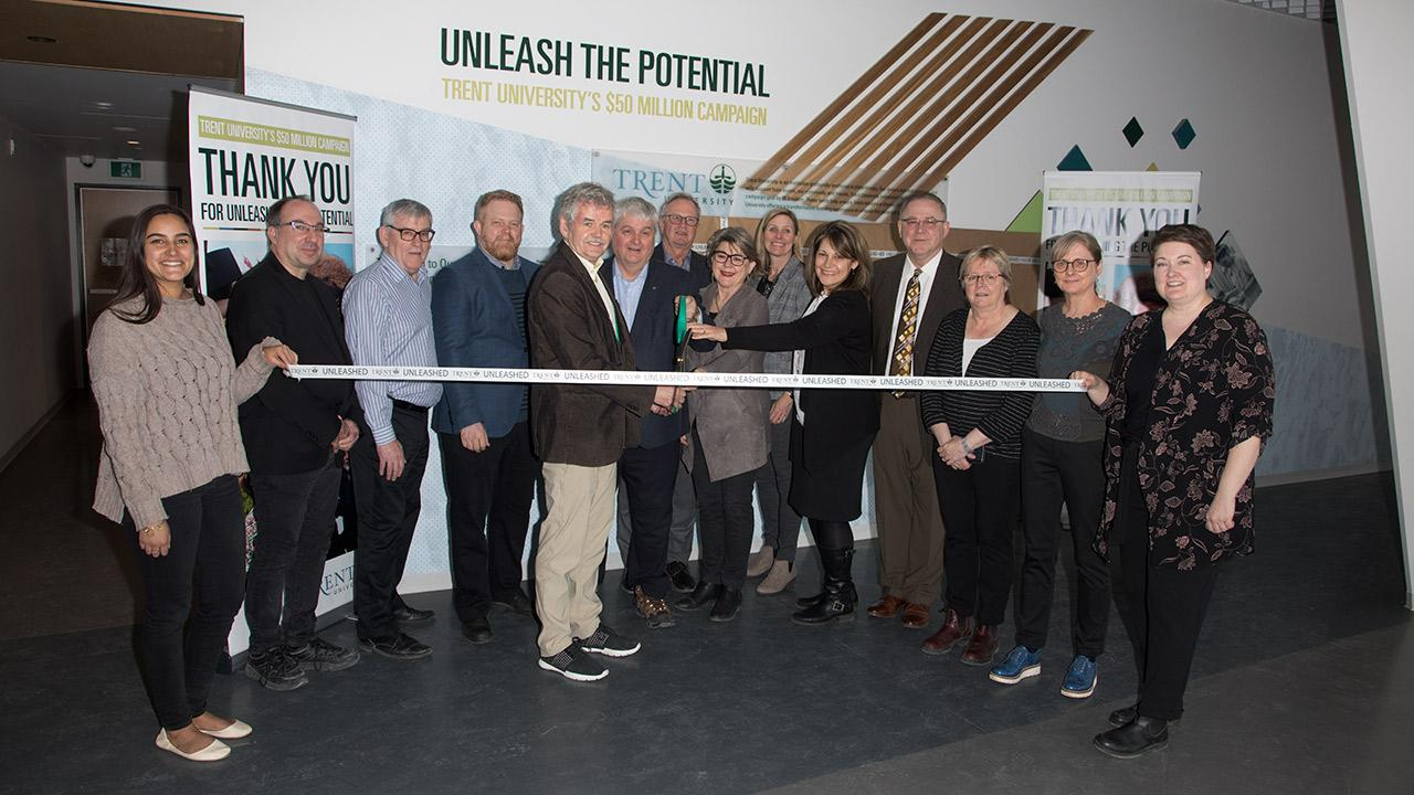 Ribbon cutting at the donor wall in the student centre atrium.