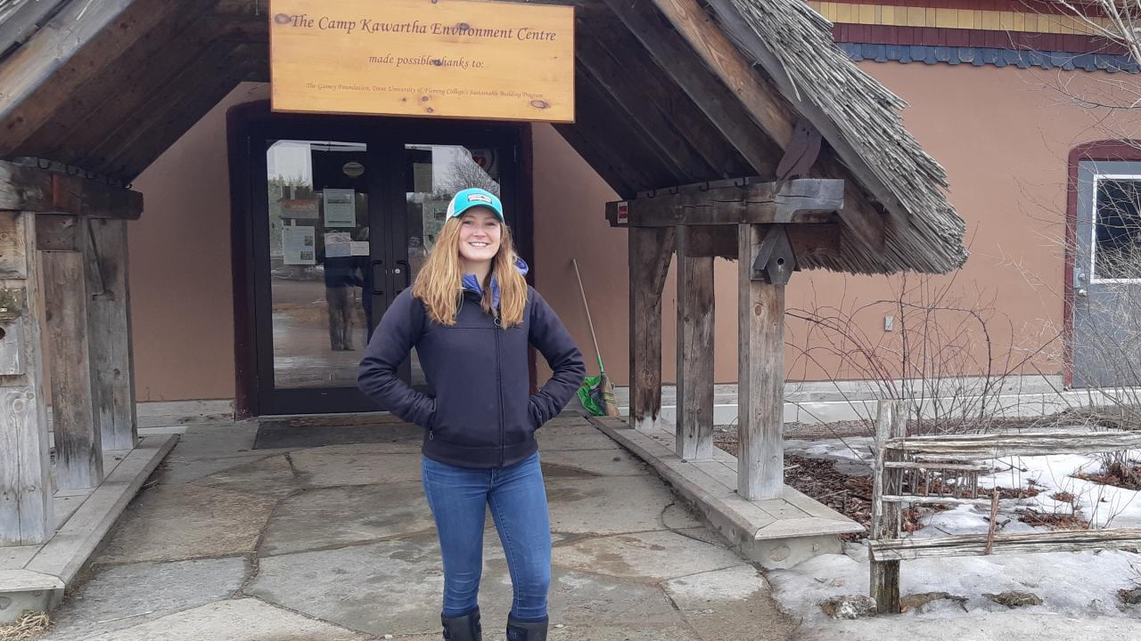 Scotia Brailsford standing in front of the Camp Kawartha Environment Centre